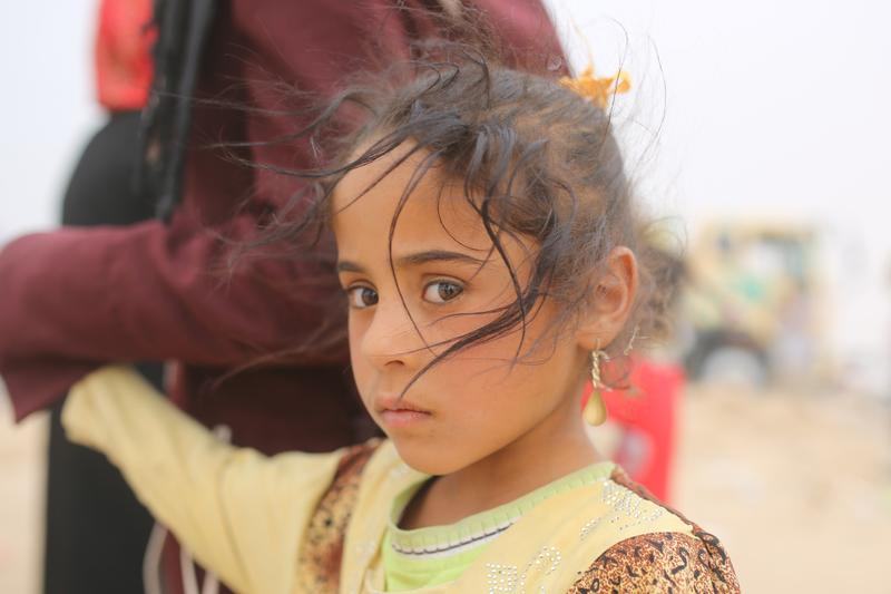 A young displaced girl from the villages near Ramadi, who she and her family have fled the clashes with ISIS, arrives to Ameriyat al-Falluja East of Anbar province. May 28, 2015