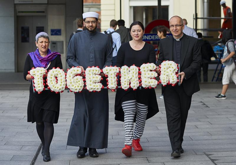 Faith leaders pose for pictures during an event to promote religious unity in central London on July 6, 2015, as Britain prepares to mark the ten year anniversary of the 7/7 London bombings.