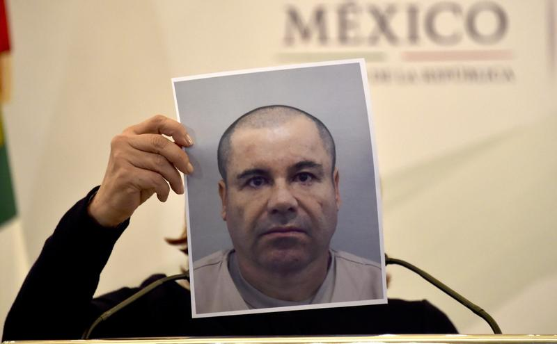 Mexico's Attorney General shows a picture of Joaquin 'El Chapo' Guzman during a press conference over the summer.