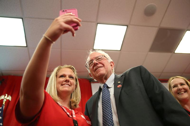U.S. Sen. Bernie Sanders takes a selfie with a nurse from the National Nurse United during a 'Brunch with Bernie' campaign rally at the National Nurses United offices on August 10, 2015 in Oakland, CA