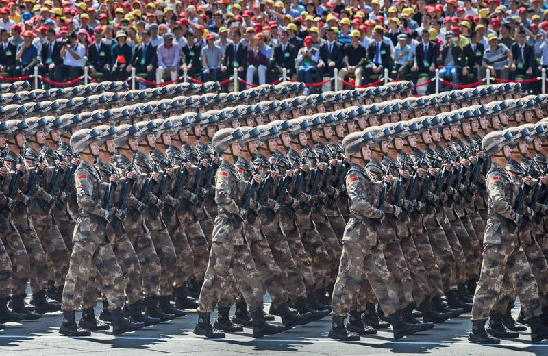 Chinese soldiers march in formation passed Tiananmen Square and the Forbidden City during a military parade on September 3, 2015 in Beijing, China.