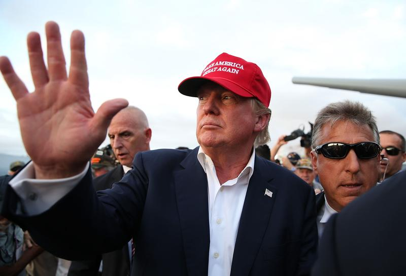 Republican presidential candidate Donald Trump waves to supporters after a campaign rally aboard the USS Iowa on September 15, 2015 in Los Angeles, California.