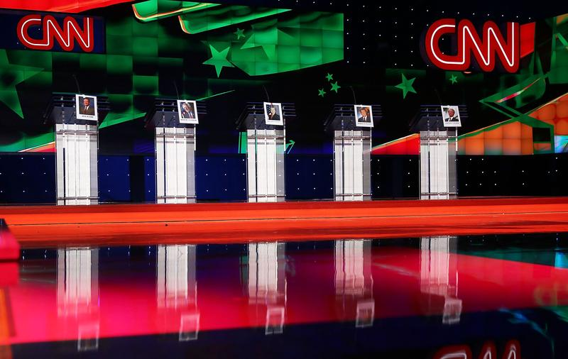 Photos of Democratic presidential candidates hang on their debate podiums a day before the CNN Facebook Democratic Debate at the Wynn Las Vegas on October 12, 2015 in Las Vegas, Nevada.