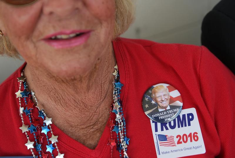 Supporters wait for the doors to open ahead of a rally by Republican presidential candidate Donald Trump on October 14, 2015 in Richmond, Virginia
