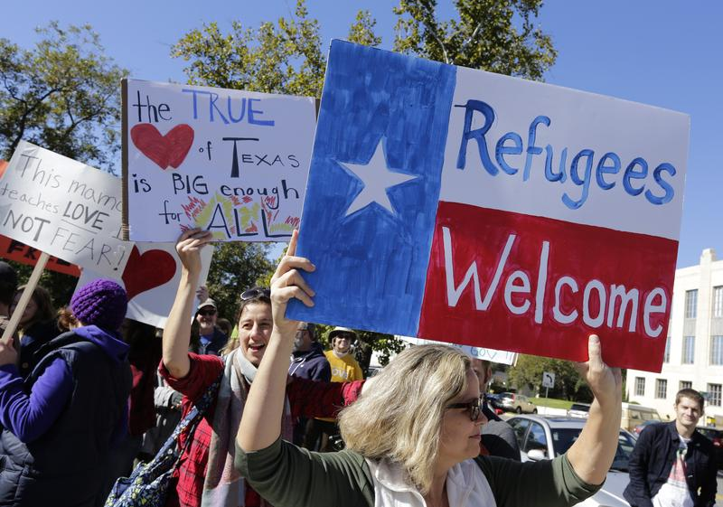 Members of The Syrian People Solidarity Group protest on November 22, 2015 in Austin, Texas.