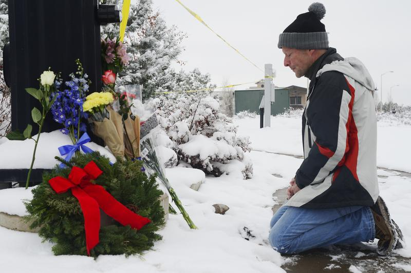 Following the shooting at Planned Parenthood, Roy Kieffer prays after laying flowers at a memorial at Fillmore Street and Centennial Boulevard on November 28, 2015 in Colorado Springs, Colorado.