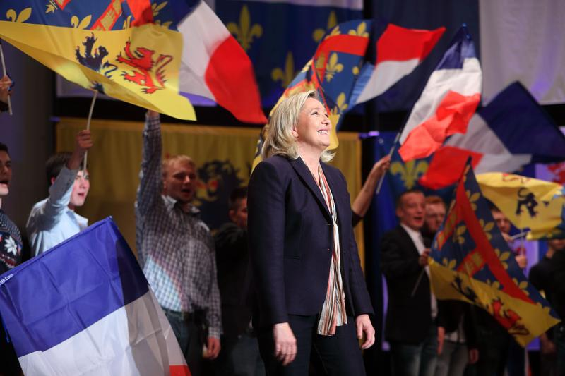 LILLE, FRANCE - NOVEMBER 30, 2015: Marine Le Pen, leader of the French far-right National Front (FN) party, smiles during a campaign rally for the upcoming regional elections.