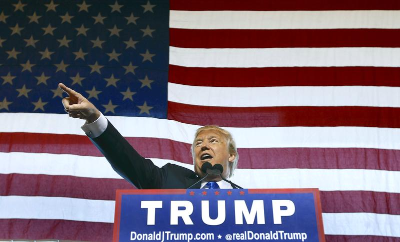 Republican presidential candidate Donald Trump speaks to guest gathered during a campaign event at the International Air Response facility on December 16, 2015 in Mesa, Arizona. Trump is in Arizona t