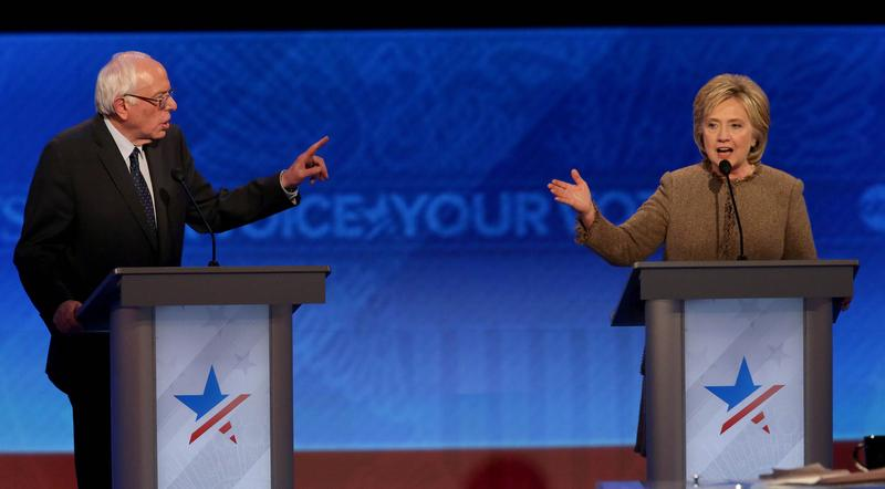 Democratic president candidates Bernie Sanders and Hillary Clinton debate at Saint Anselm College December 19, 2015 in Manchester, New Hampshire.