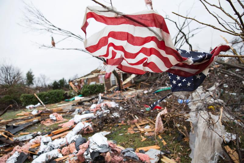 An American flag placed by first responders is seen December 27, 2015 in the aftermath of a tornado in Rowlett, Texas.