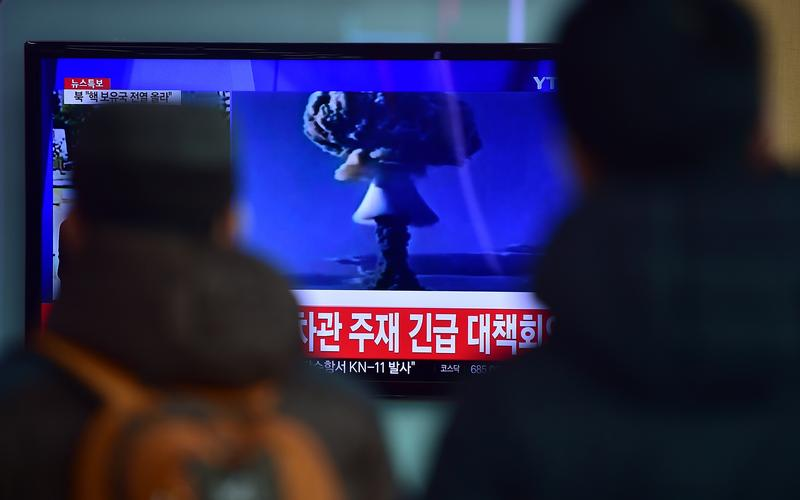 People watch a news report on North Korea's first hydrogen bomb test at a railroad station in Seoul on January 6, 2016. South Korea 'strongly' condemned North Korea's shock hydrogen bomb test and vowe