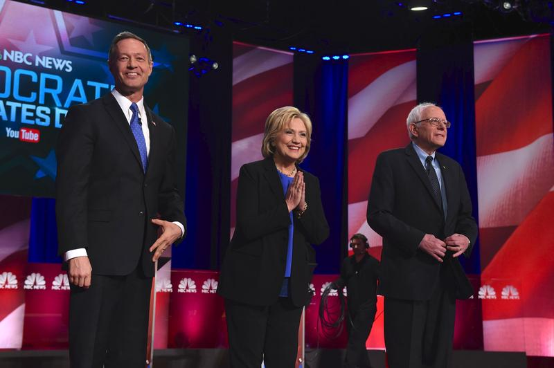 Former Maryland Gov. Martin O'Malley, former Sec. of State Hillary Clinton, and Vermont Senator Bernie Sanders arrive on stage for the Democratic debate in Charleston, SC. Jan. 17, 2016