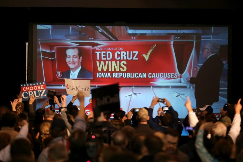 People cheers as Republican presidential candidate Sen. Ted Cruz (R-TX) is declared the winner at the caucus night gathering at the Iowa State Fairgrounds on February 1, 2016 in Des Moines, Iowa.