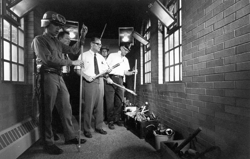 14th September 1971, Guards look over home made weapons confiscated during Attica State Correctional Facility prison riot.