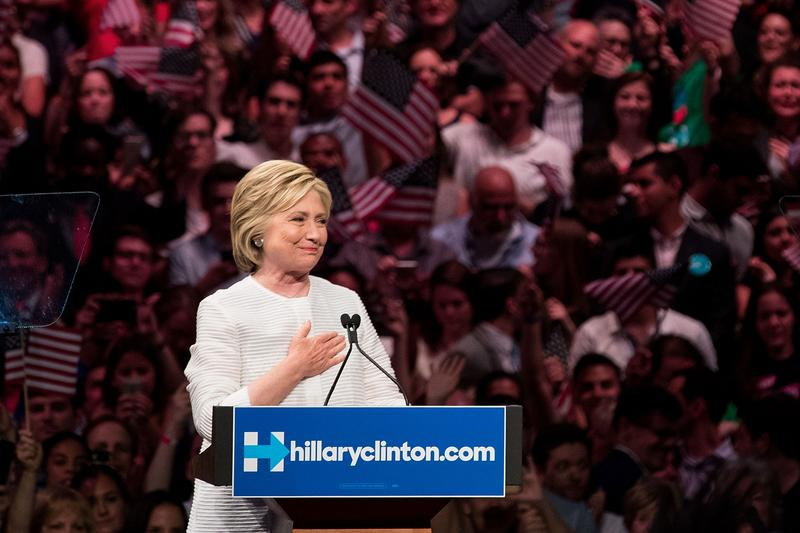 Democratic presidential candidate Hillary Clinton gestures to the crowd at the start of her remarks during a primary night rally at the Duggal Greenhouse in the Brooklyn Navy Yard, June 7, 2016.