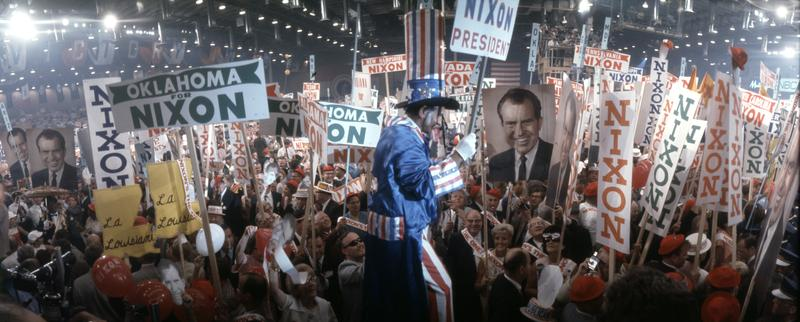 View of a man dressed as Uncle Sam, entertaining a crowd holding Nixon signs at the 29th Republican National Convention in Miami, Florida, August 5-8, 1968.