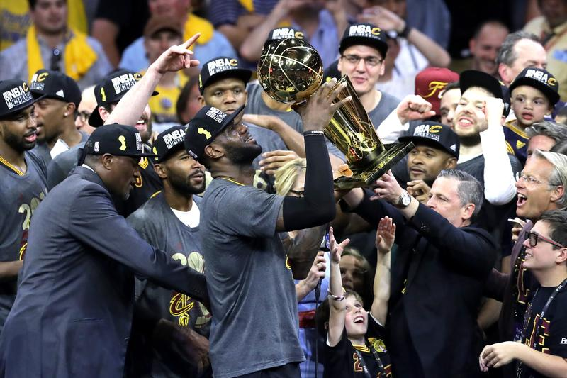 LeBron James of the Cleveland Cavaliers holds the Larry O'Brien Championship Trophy after defeating the Golden State Warriors 93-89 in Game 7 of the 2016 NBA Finals at ORACLE Arena on June 19, 2016.