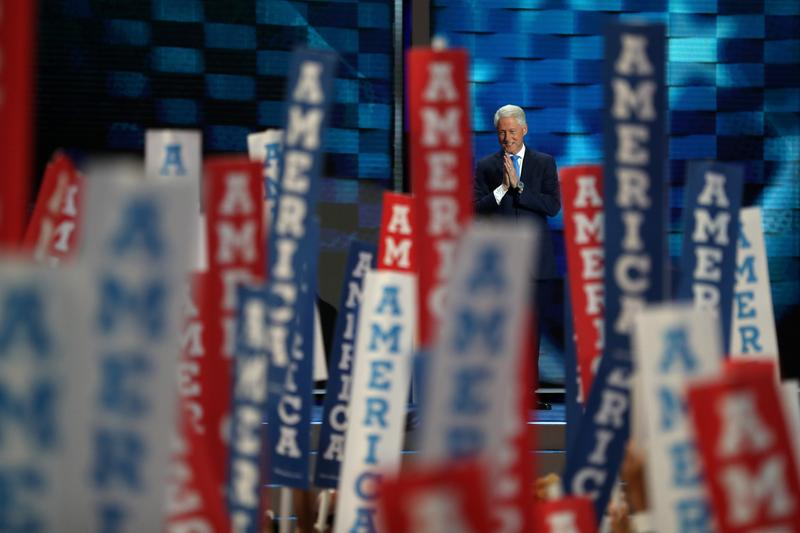 Former US President Bill Clinton arrives on stage to deliver remarks on the second day of the Democratic National Convention at the Wells Fargo Center, July 26, 2016.