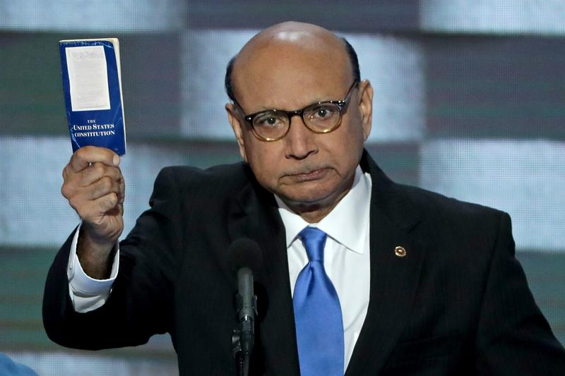 Khizr Khan, father of deceased Muslim U.S. Soldier, holds up a booklet of the US Constitution as he delivers remarks on the fourth day of the Democratic National Convention. July 28, 2016