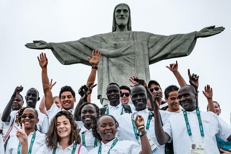 Athletes of the 2016 Refugee Olympic Team take pictures in Rio de Janeiro, July 30, 2016. Swimmer Nusra Mardini is the 2nd person in the bottom row.