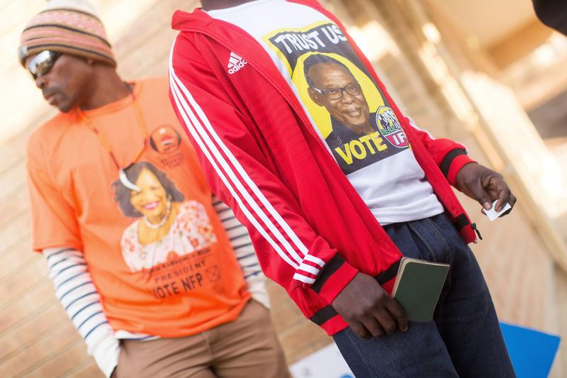 South African voters wearing t-shirts of the National Freedom Party and Inkatha Freedom party (IFP) arrive at a polling station, August 03, 2016.