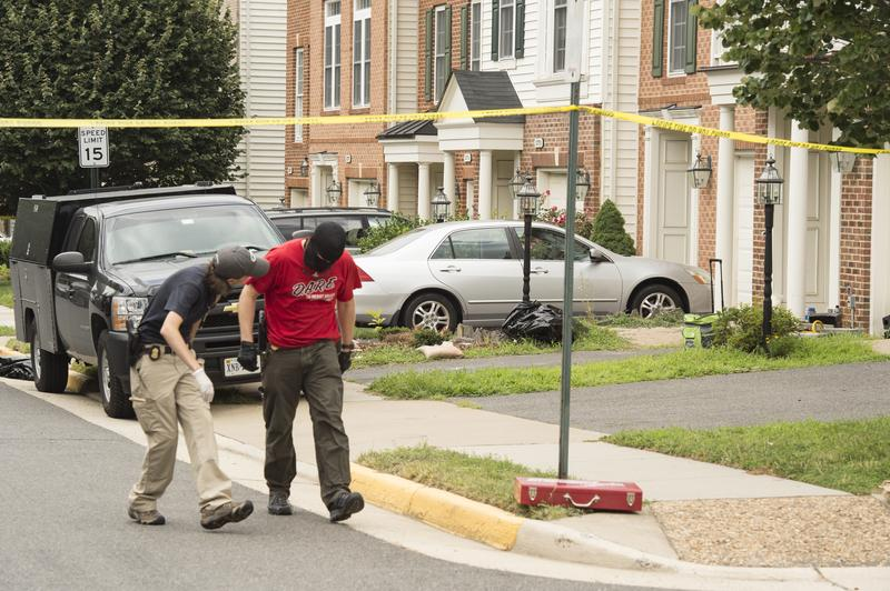 Police search the home of Metro Transit police officer Nicholas Young, 36, of Fairfax, Va., who has been arrested and charged with attempting to provide material support to the Islamic State.