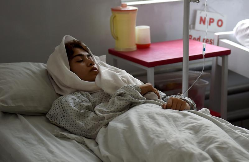 A wounded Afghan girl student from the American University receives treatment, following the militants' raid that targeted the elite American University of Afghanistan. Aug. 25, 2016