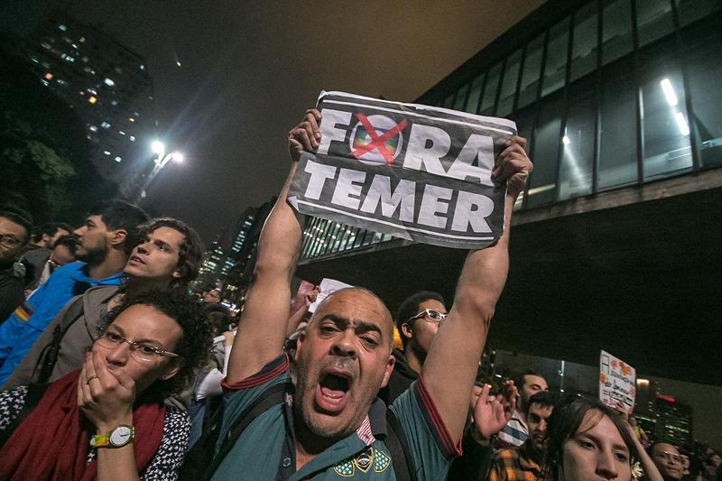 Thousands of people holding banners and shouting slogans do rally in favor of the former president of Brazil, Dilma Rousseff on Paulista Avenue in Sao Paulo, Brazil on August 31, 2016.