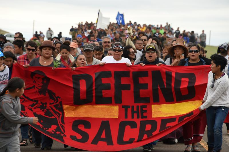 Native Americans march to a burial ground sacred site that was disturbed by bulldozers building the Dakota Access Pipeline (DAPL).  September 4, 2016