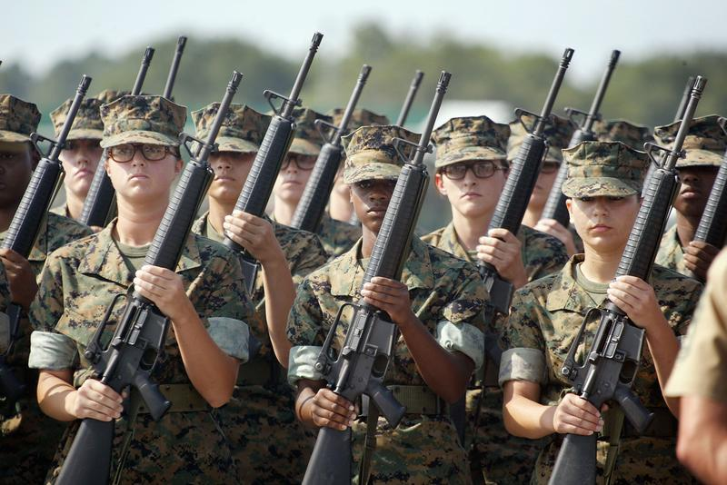 Female Marine Corps recruits pratice drill at the United States Marine Corps recruit depot June 22, 2004 in Parris Island, South Carolina.