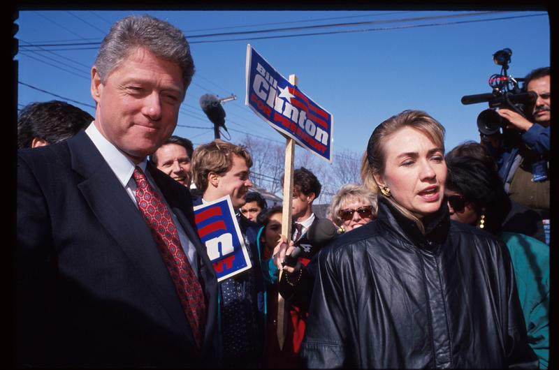 Hillary and Bill Clinton speak to reporters February 16, 1992 in New Hampshire. Mrs. Clinton was campaigning for her husband to be the Democratic party's presidential nominee.