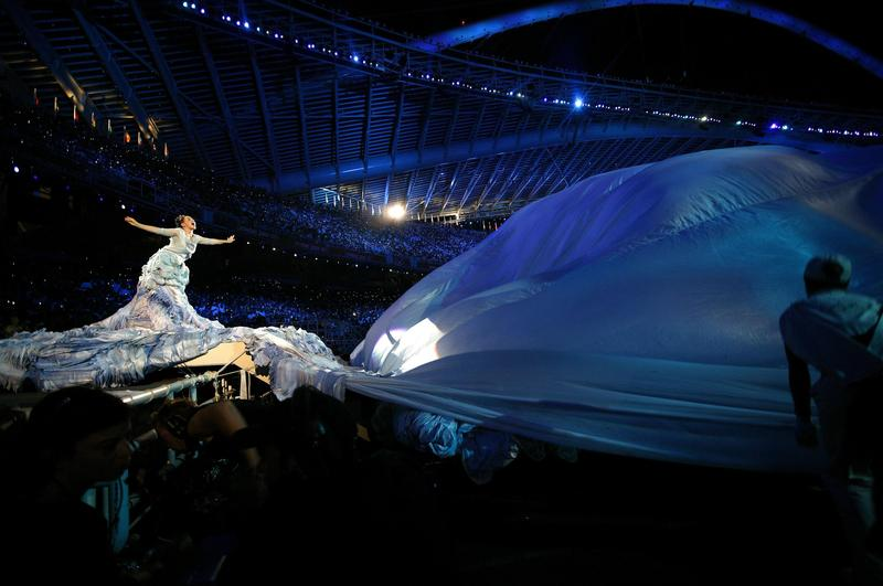 Bjork performing on stage at the opening of the 2004 Athens Olympics.