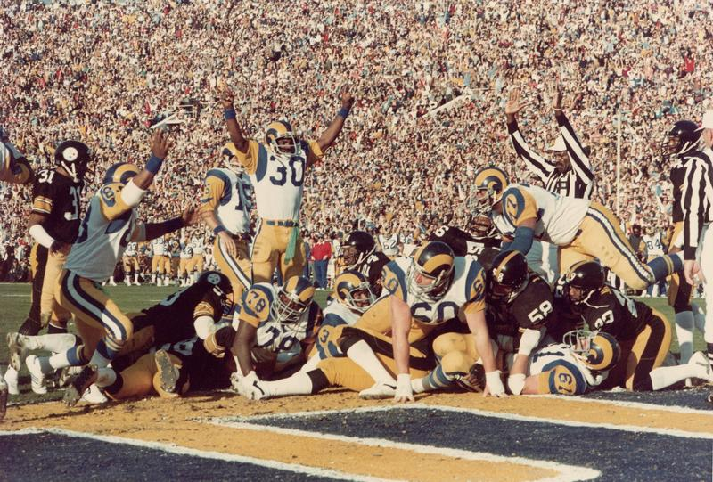 Lawrence McCutcheon #30 of the Los Angeles Rams celebrates as Cullen Bryant #32  scores a touchdown during Super Bowl XIV against the Pittsburgh Steelers at the Rose Bowl on January 20, 1980.