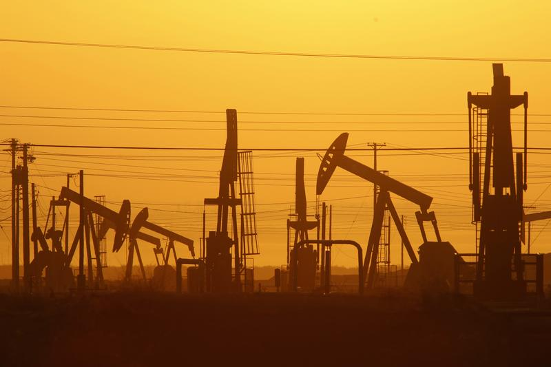 Pump jacks at dawn in an oil field over the Monterey Shale formation, where gas and oil extraction using hydraulic fracturing is on the verge of a boom on March 24, 2014, near Lost Hills, CA