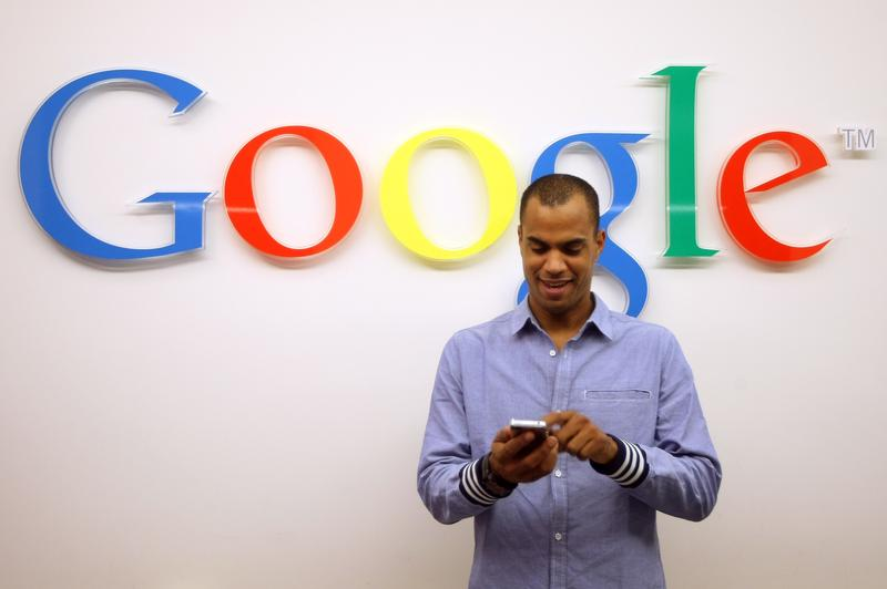 A man uses a phone at a Google corporate branch