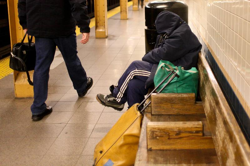 Homeless woman in Lower Manhattan subway station.