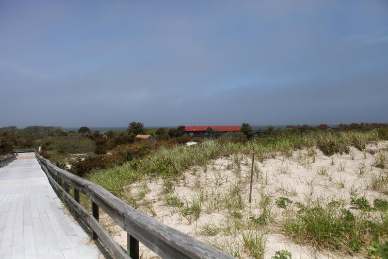 The fog lifts for a moment and the landing at Sailors Haven Fire Island National Seashore is visible from the beach.