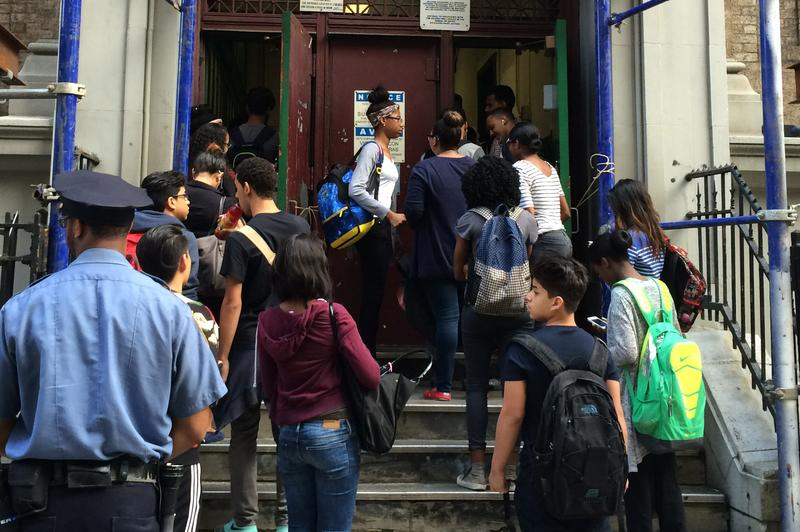High school students wait to pass through metal detectors at the Washington Irving Campus near Union Square.