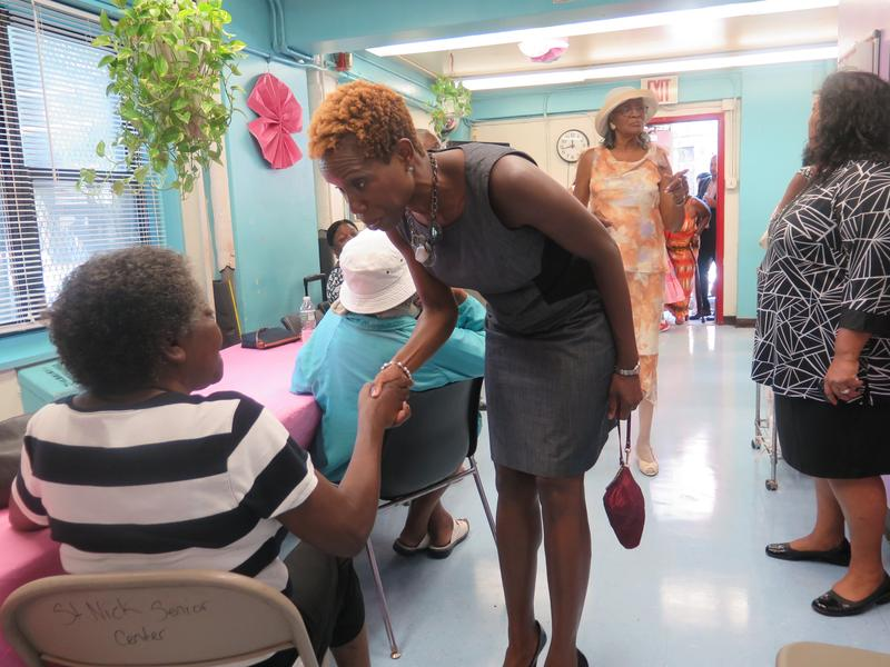 Shola Olatoye meets and greets seniors at  Wagner Houses, a development with a high crime problem.