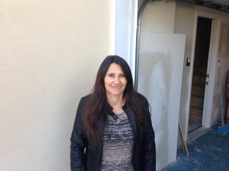 Eleni Stavrakos-Ocampo in front of her home on Staten Island.