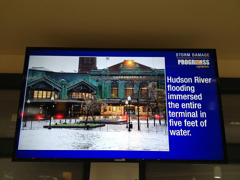 In the track area, NJ Transit constantly loops a slideshow of Sandy damage