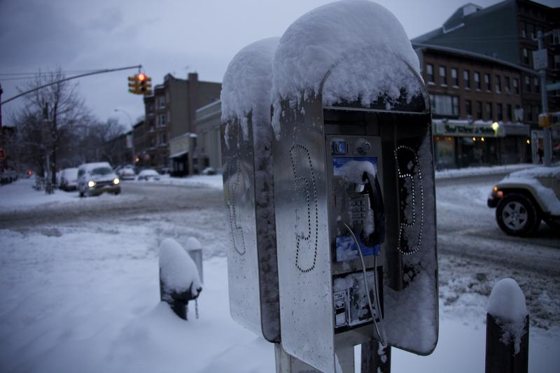 A pay phone wears a cap of snow in Park Slope, Brooklyn.