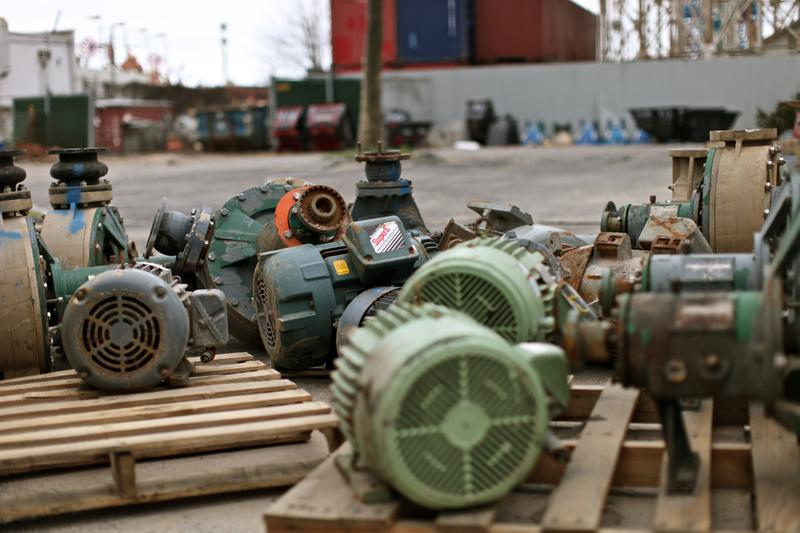 Pumps, motors and filters that were ruined when Sandy flooded the New York Aquarium are arranged in a former parking lot.