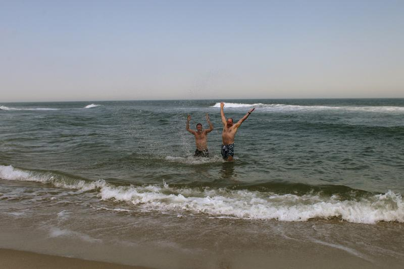 Steve Zemann and Michael Barich take a dip in the ocean at the municipal beach in Sea Bright, NJ.