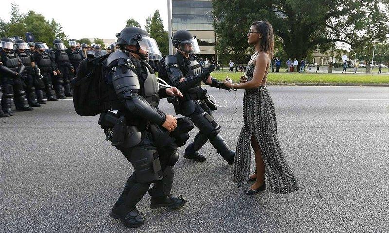 Ieshia Evans stands before policemen in riot gear in Baton Rouge, LA July 9, 2016