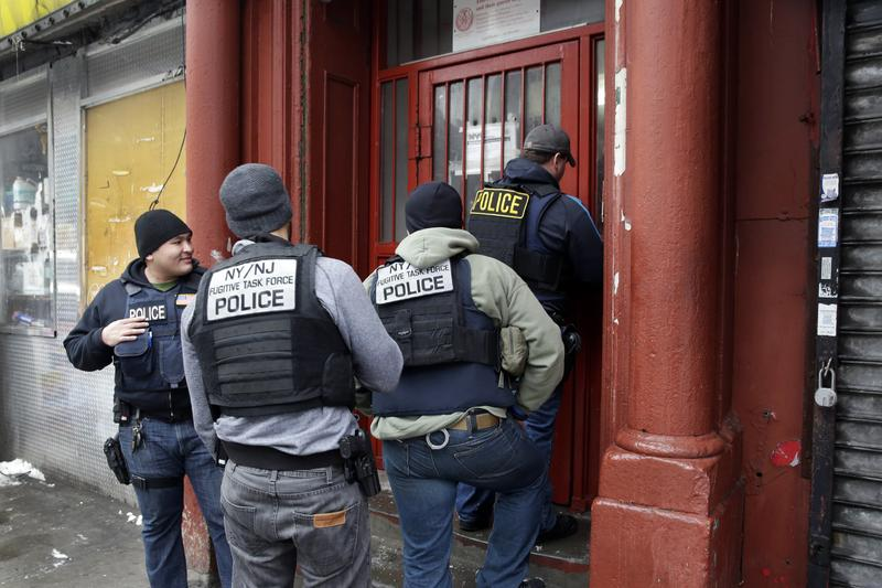 Immigration and Customs Enforcement officers make arrests in the Bronx in March 2015.