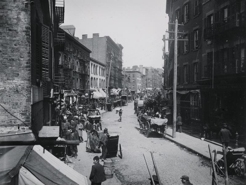 View of Mulberry Bend published by Jacob Riis in How the Other Half Lives, 1890. Columbus Park now occupies the left side of the street.