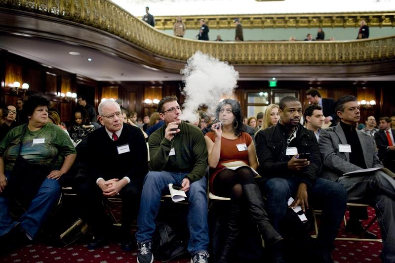 A protestor at New York City Council vapes, before the Council added e-cigarettes to the Indoor Clean Air Act. Some health leaders want to extend that ban to the rest of the state and beyond.