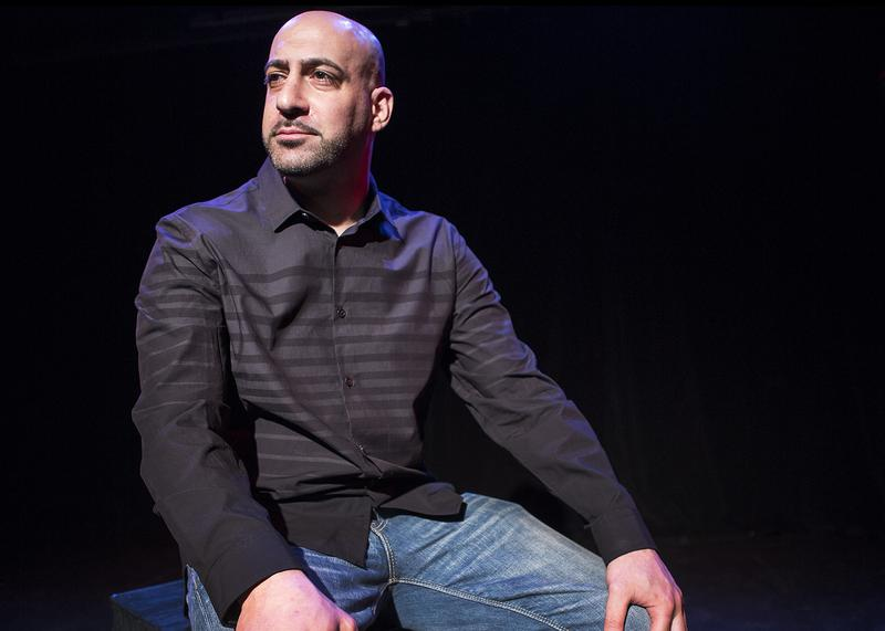 "Joe Assadourian in ""The Bullpen,"" a one-man comedy that he wrote about his experiences in prison."