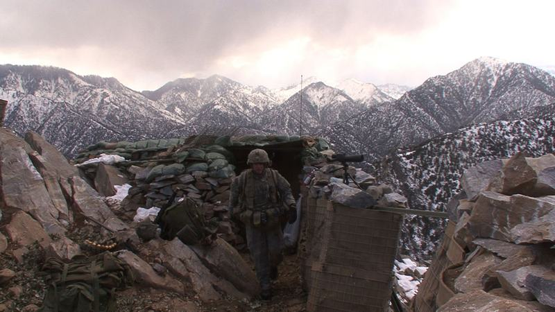 "SFC Patterson checking his men at OP, in ""Korengal,"" a documentary directed by Sebastian Junger"